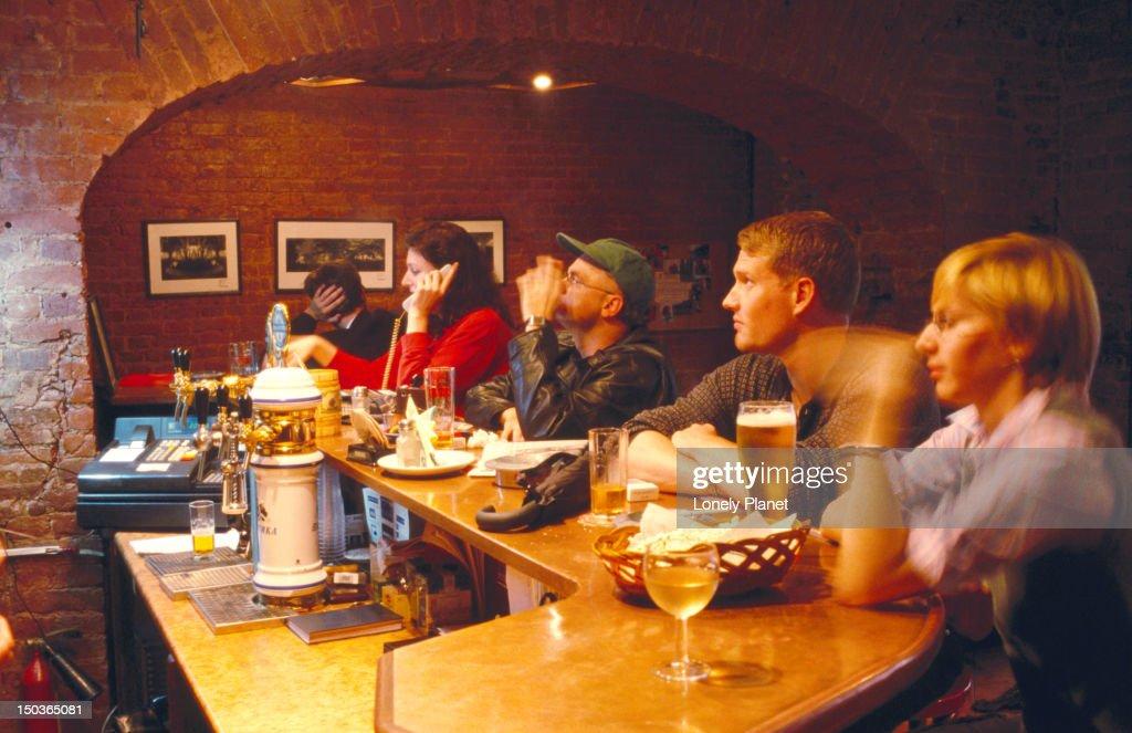 Patrons at City Bar. : Stock Photo