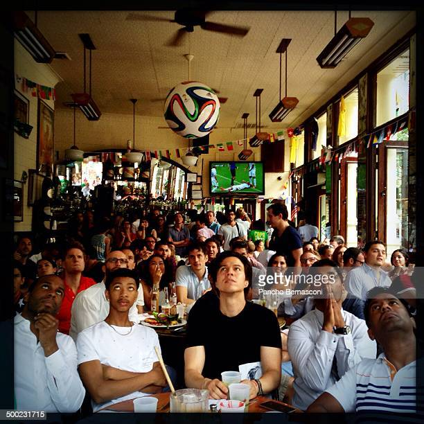 Patrons at Felix restaurant watching USA vs Germany soccer World Cup match in the SOHO neighborhood of New York City