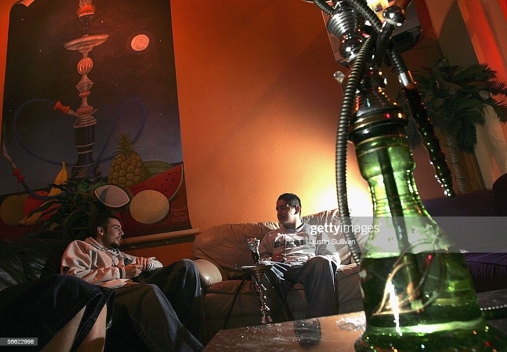 Patrons at the Hookah Nites Cafe smoke hookah pipes January 18, 2006 in San Jose, California. The ancient Middle-Eastern practice of smoking flavored tobaccos through a tall, ornate water pipe, better known as hookah, has become increasingly popular throughout the United States. Hookah lounges are becoming trendy in college towns and are appealing to people from all walks of life.