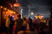 Patrons attend the reopening ceremony for Sunny's Bar a landmark bar that has been open for over a century on August 29 2013 in the Red Hook...