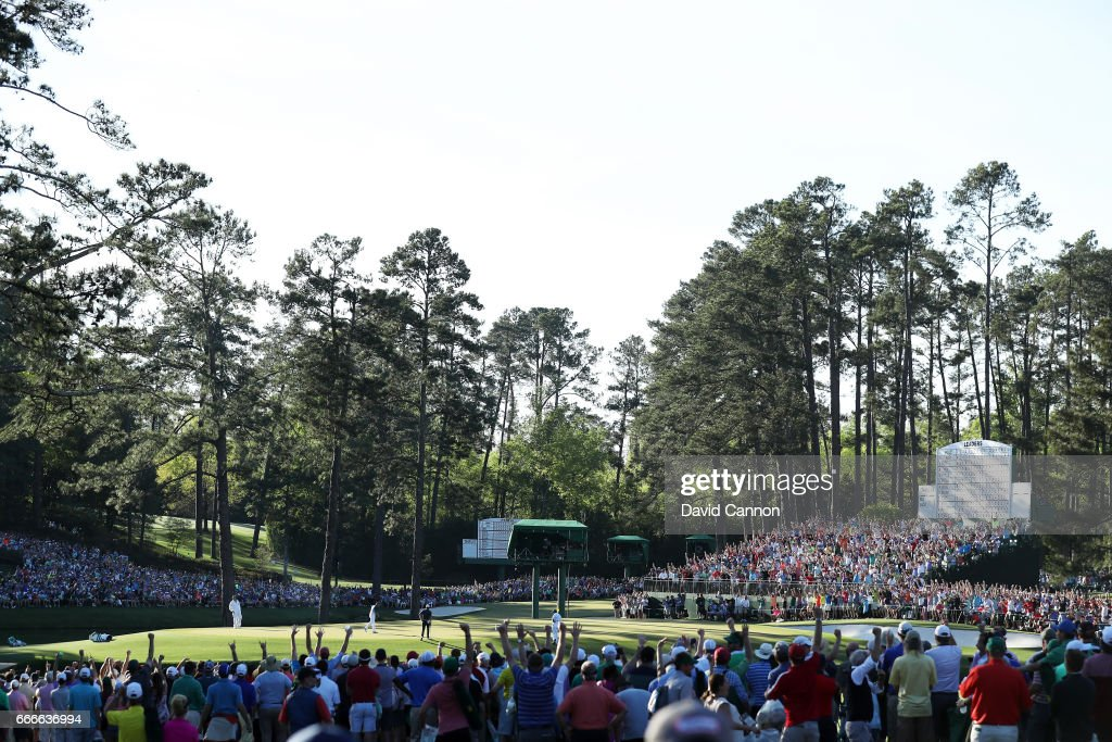 Patrons cheer as Sergio Garcia of Spain celebrates making a putt for eagle on the 15th hole during the final round of the 2017 Masters Tournament at Augusta National Golf Club on April 9, 2017 in Augusta, Georgia.