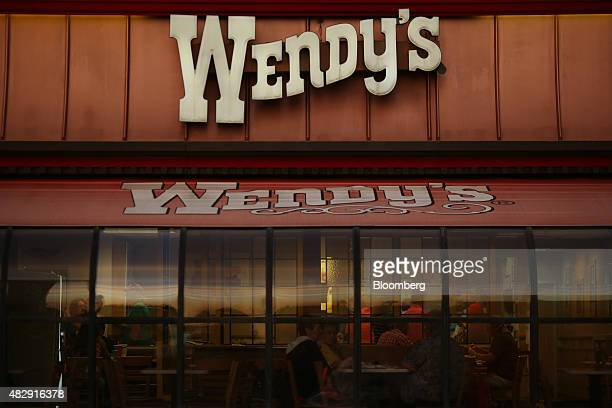 Patrons dine at a Wendy's Co restaurant in Mt Vernon Illinois US on Wednesday July 29 2015 Wendy's Co is scheduled to release quarterly earnings on...
