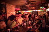 Patrons drink at the reopening ceremony for Sunny's Bar a landmark bar that has been open for over a century on August 29 2013 in the Red Hook...