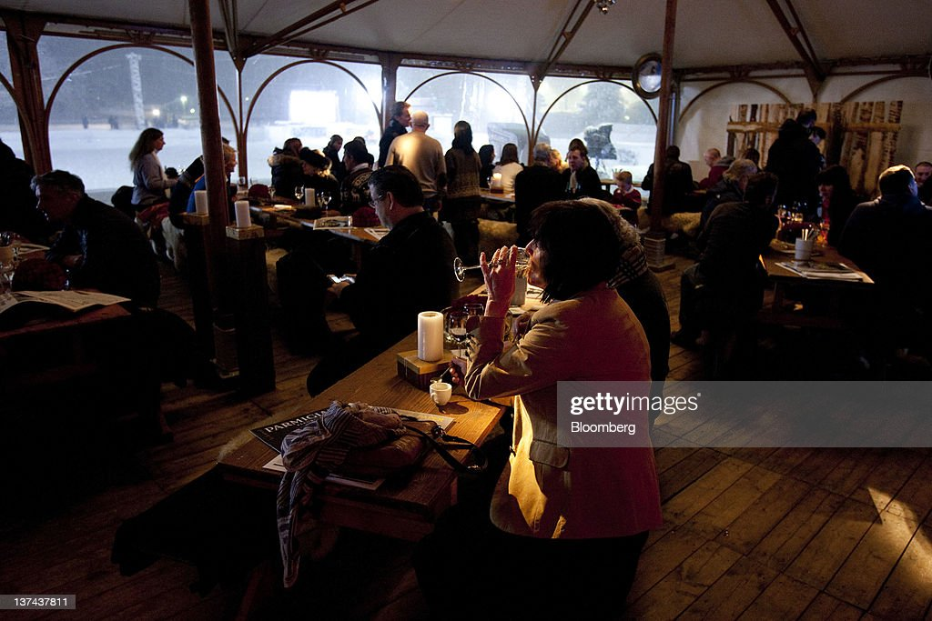 Patrons drink wine in the VIP tent at the annual Klosters Snow Polo event in Klosters, Switzerland, on Friday, Jan. 20, 2012. German Chancellor Angela Merkel will open next week's World Economic Forum in Davos, Switzerland, which will be attended by policy makers and business leaders including U.S. Treasury Secretary Timothy F. Geithner. Photographer: Scott Eells/Bloomberg via Getty Images