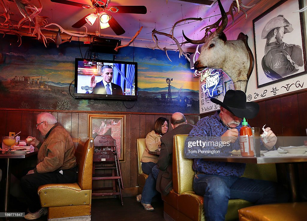 Patrons eat at Fred's Texas Cafe as a television shows U.S. President <a gi-track='captionPersonalityLinkClicked' href=/galleries/search?phrase=Barack+Obama&family=editorial&specificpeople=203260 ng-click='$event.stopPropagation()'>Barack Obama</a> being officially sworn in for his second term as on January 20, 2013 in Fort Worth. Obama was officially sworn in for a second term in a private ceremony at the White House ahead of a full day of public events to be held on January 21.