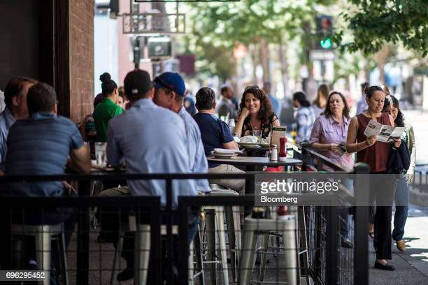 Patrons eat lunch at a restaurant in the downtown area of Sacramento California US on Tuesday June 6 2017 As the cost of daily life tests the bounds...