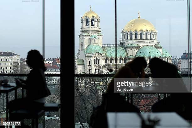Patrons enjoy a drink with the Alexander Nevsky Cathedral as a backfdrop on January 31 2016 in Sofia Bulgaria