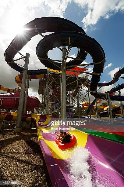 Patrons enjoy a water slide at the opening of Sydney theme park Wet'n'Wild on December 12 2013 in Sydney Australia The new water park featuring 42...