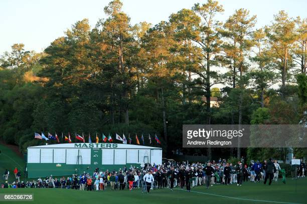 Patrons enter as the course is opened during the first round of the 2017 Masters Tournament at Augusta National Golf Club on April 6 2017 in Augusta...