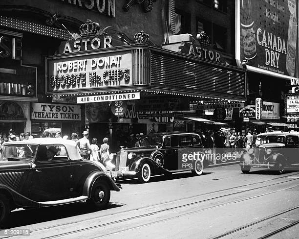 Patrons gather under the kiosk of the Astor Theatre at 1531 Broadway New York New York mid 1939 The kiosk advertises Sam Wood's 1939 film 'Goodbye Mr...