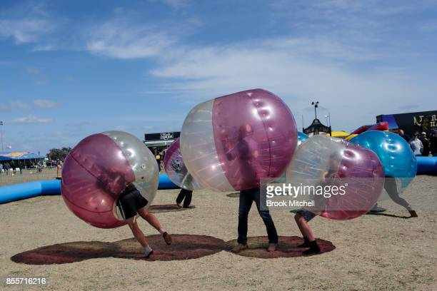 Patrons have a go at 'Bubble Soccer' at the 2017 Deni Ute Muster on September 30 2017 in Deniliquin Australia The annual Deniliquin Ute Muster is the...