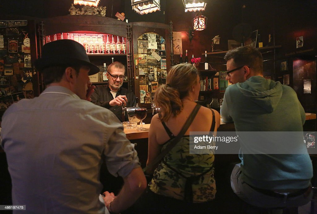 Patrons have drinks at the Alt Berlin (Old Berlin) bar on April 22, 2014 in Berlin, Germany. The bar, which opened in 1893 and is known for its familial atmosphere, is claimed to be the oldest bar in the German capital, a city with few remaining pre-War drinking establishments in comparison to other major European cities. A petition has been launched to convince the bar's landlord to allow the business to stay open after its expected closure at the end of the month due to skyrocketing real estate prices in the city's popular and central Mitte neighborhood.