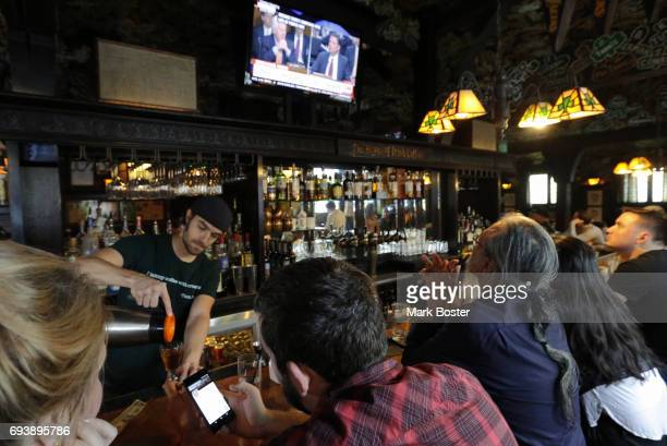 Patrons in Tom Bergin's Public House on Fairfax watch the Comey testimony June 8 2017