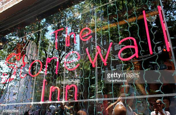 Patrons inside take pictures of those gathering outside the Stonewall Inn June 26 2015 in the West Village neighborhood in New York City The iconic...