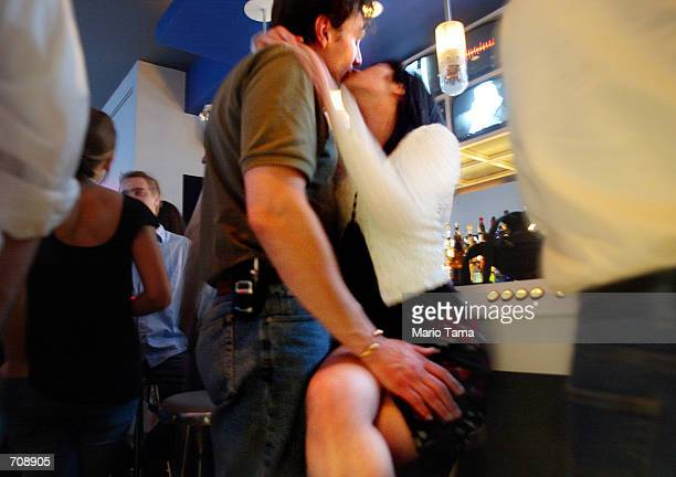Patrons kiss in the new digital nightlife lounge Remote April 19 2002 in New York City Remote uses interactive technologies including 60 video...