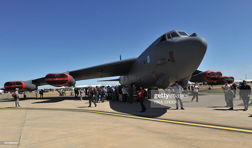 Patrons line up to look through a US Air Force B-52 bomber during the Australian International Airshow in Melbourne on March 1, 2013. 180,000 patrons are expected through the gates over the duration of the event staged at the Avalon Airfield some 80kms south-west of Melbourne. AFP PHOTO / Paul CROCK