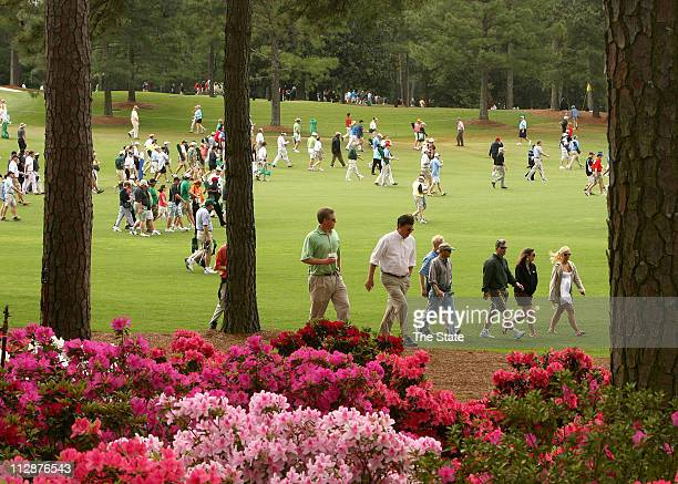 Patrons make their way across the course towards Amen Corner during the second round of The Masters Tournament at Augusta National Golf Club in...