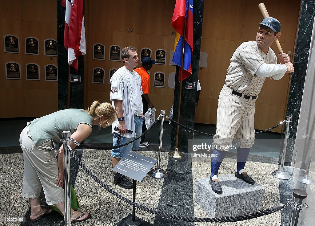 Patrons of the Baseball Hall Of Fame and Museum view a statue of Babe Ruth during induction weekend on July 24 2010 in Cooperstown New York