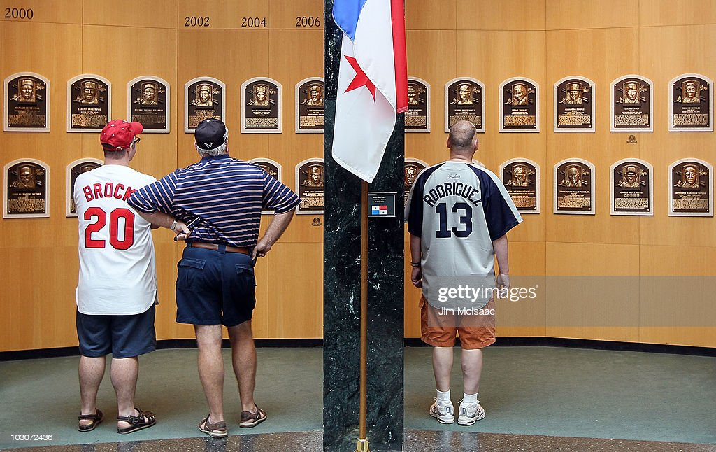 Patrons of the Baseball Hall of Fame and Museum view the plaques of inducted members during induction weekend on July 24, 2010 in Cooperstown, New York.