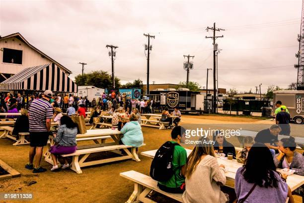 WACO, TX, USA  MARCH 18, 2017: Patrons of the food trucks on the grounds of Magnolia Market eating on picnic tables.