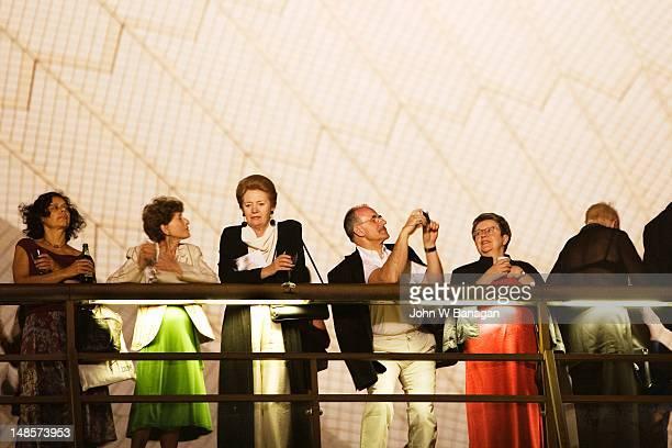 Patrons on balcony of Sydney Opera House.