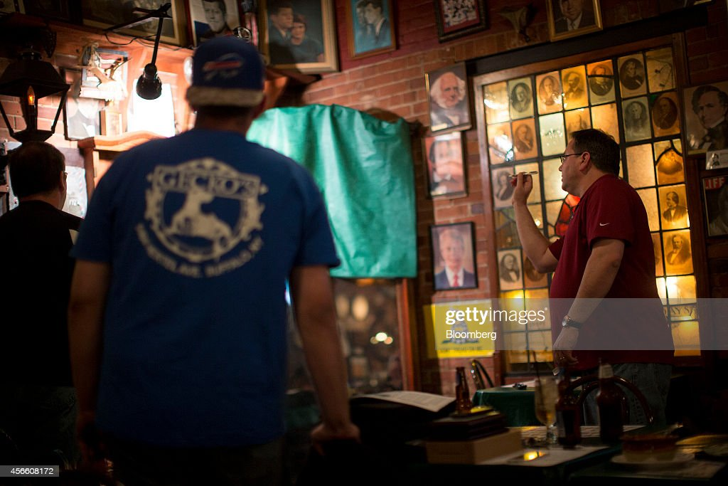 Patrons play darts at the Founding Fathers Pub in Buffalo New York US on Tuesday Sept 23 2014 The Federal Reserve Bank of New York's empire state...