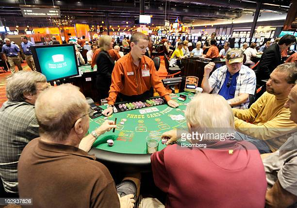 Patrons play poker at the Sands Casino Resort in Bethlehem Pennsylvania US on Friday July 16 2010 Three casinos in Eastern Pennsylvania including the...