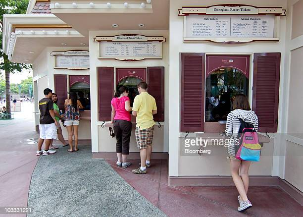 Patrons purchase tickets at Walt Disney Co's Disneyland amusement park in Anaheim California US on Thursday Aug 5 2010 Walt Disney Co the world's...