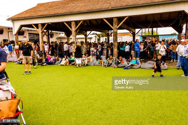 WACO, TX, USA  MARCH 18, 2017: Patrons relax on striped beanbag seats as the await entry to Magnolia Market at the Silos..