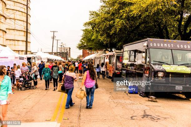 WACO, TX, USA  MARCH 18, 2017: Patrons shopping at food trucks and vendor tents on the street outside of Magnolia Silos.