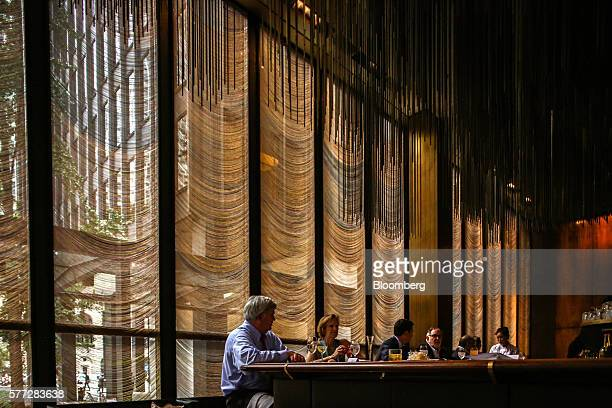 Patrons sit for lunch service at the Four Seasons restaurant in New York US on Wednesday July 13 2016 The Four Seasons which opened when Dwight...