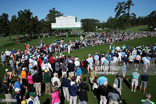 Patrons stand around the eighth tee box during a practice round prior to the start of the 2016 Masters Tournament at Augusta National Golf Club on...
