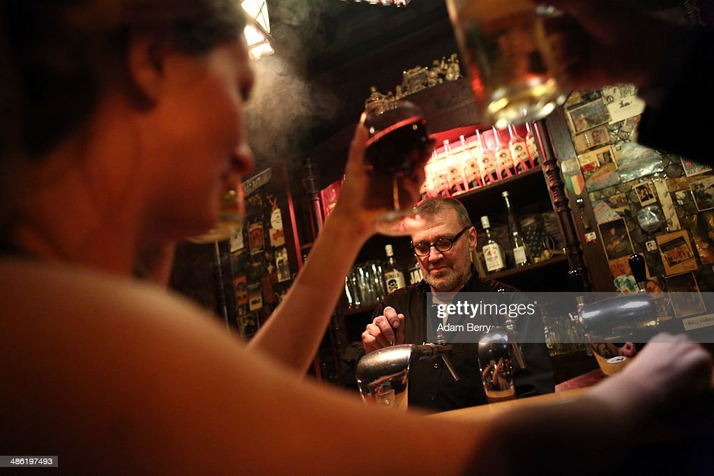 Patrons toast one another as a bartender serves drinks at the Alt Berlin (Old Berlin) bar on April 22, 2014 in Berlin, Germany. The bar, which opened in 1893 and is known for its familial atmosphere, is claimed to be the oldest bar in the German capital, a city with few remaining pre-War drinking establishments in comparison to other major European cities. A petition has been launched to convince the bar's landlord to allow the business to stay open after its expected closure at the end of the month due to skyrocketing real estate prices in the city's popular and central Mitte neighborhood.
