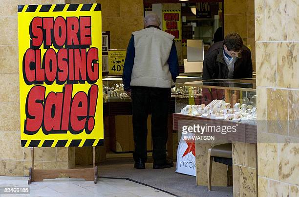 Patrons walk through a store that is going out of business in Annapolis Marylandon October 28 2008 US consumer confidence plunged to a record low in...