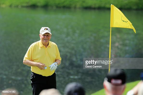 Patrons watch as Jack Nicklaus celebrates his holeinone on the fourth hole during the Par 3 Contest prior to the start of the 2015 Masters Tournament...
