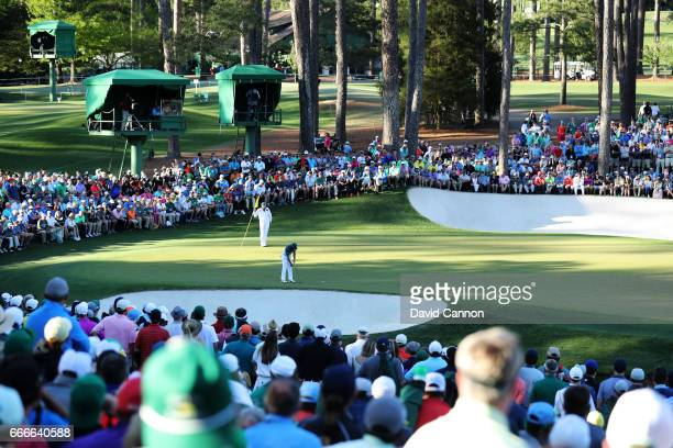 Patrons watch as Sergio Garcia of Spain putts on the 16th green during the final round of the 2017 Masters Tournament at Augusta National Golf Club...