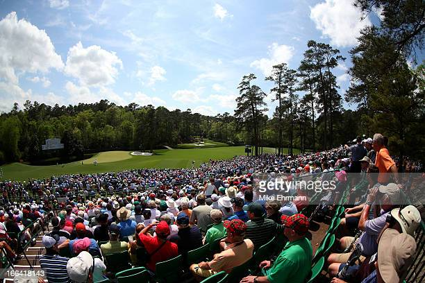 Patrons watch play at Amen Corner during the second round of the 2013 Masters Tournament at Augusta National Golf Club on April 12 2013 in Augusta...