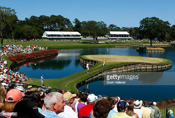 Patrons watch play on the 17th green during the final round of THE PLAYERS Championship held at THE PLAYERS Stadium course at TPC Sawgrass on May 9...