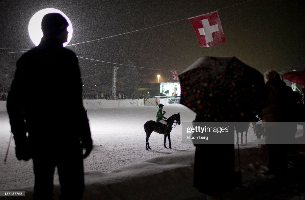Patrons watch the annual Klosters Snow Polo event in Klosters, Switzerland, on Friday, Jan. 20, 2012. German Chancellor Angela Merkel will open next week's World Economic Forum in Davos, Switzerland, which will be attended by policy makers and business leaders including U.S. Treasury Secretary Timothy F. Geithner. Photographer: Scott Eells/Bloomberg via Getty Images
