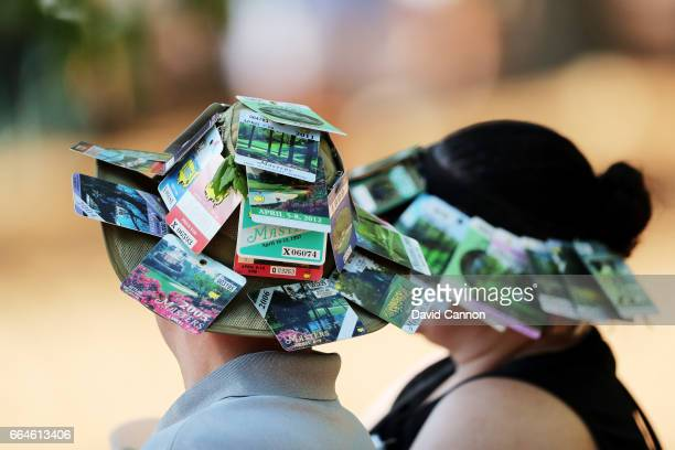 Patrons wear Masters' badges on their hats as seen during a practice round prior to the start of the 2017 Masters Tournament at Augusta National Golf...