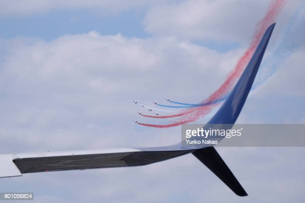 Patrouille de France performing an aerial demonstration is seen past an Airbus A380plus winglet over the Le Bourget Airport on the first public day...