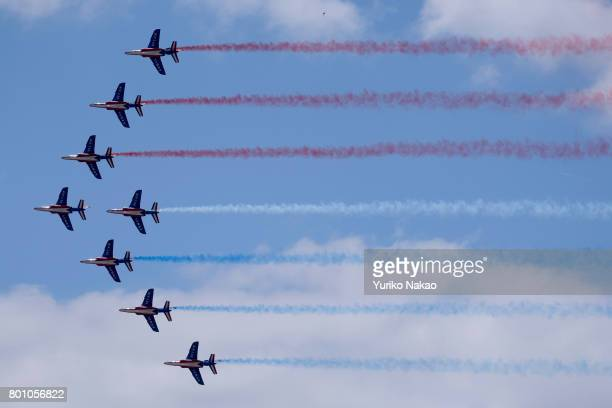 Patrouille de France performs an aerial demonstration over the Le Bourget Airport on the first public day of the 52nd International Paris Air Show on...