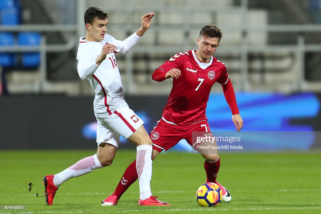 Patryk Dziczek of Poland and Mikkel Duelund of Denmark during UEFA U21 Championship Qualifier match between Poland and Denmark on November 14, 2017 in Gdynia, Poland.