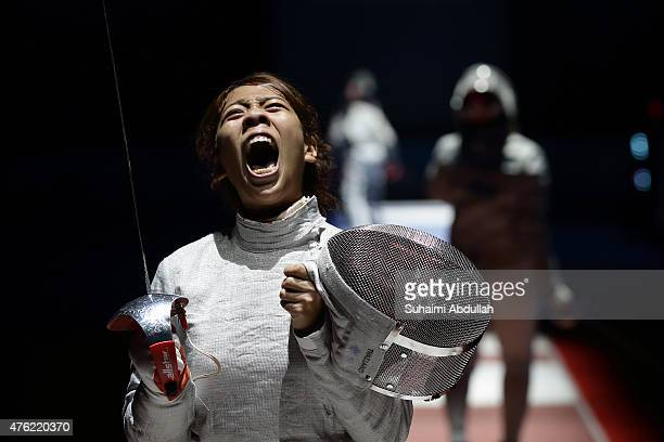 Patsara Manuya of Thailand reacts during her fight with Novi Susanti of Indonesia in the women's fencing team sabre semifinals at the OCBC Arena Hall...