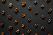 Patterened Coffee Beans on Black Background