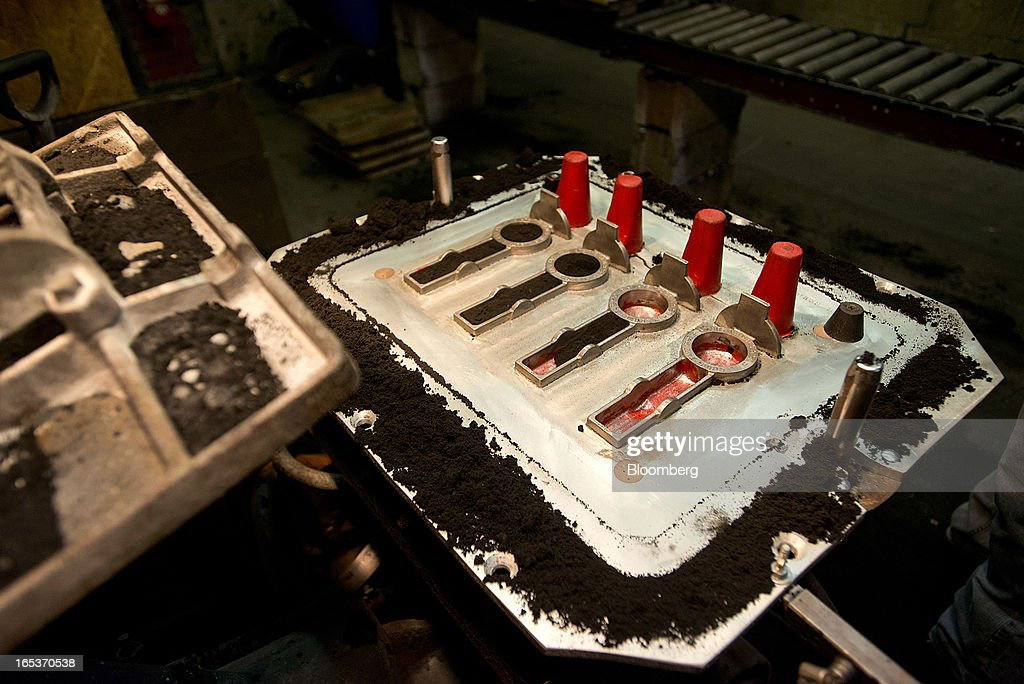 A pattern for geological surveying tools sits on the table of a squeeze machine waiting before being put into a mold for aluminum casting at the Capital Brass & Aluminum Foundry in Columbus, Ohio, U.S., on Wednesday, April 3, 2013. Capital Brass & Aluminum Foundry, established in 1937, is a 7500 square foot facility which offers complete alloy sand casting services. Photographer: Ty Wright/Bloomberg via Getty Images