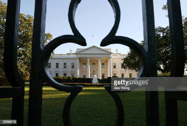 A pattern from the White House fence is seen in front of the building October 2 2003 in Washington DC According to a Washington Post/ABC News poll...