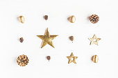 Christmas composition. Pattern made of christmas decoration, pine cones. Flat lay, top view