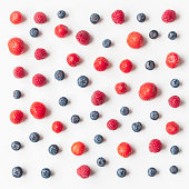 Pattern made of fresh strawberry, blueberry, raspberry. Fresh fruits. Flat lay, top view, square