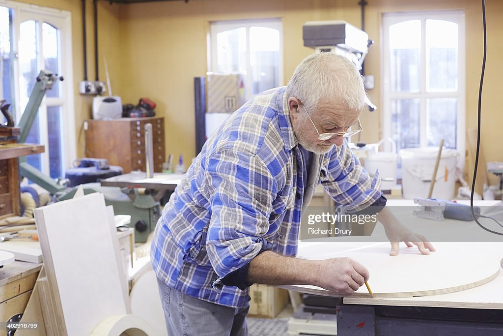 Pattern maker marking out a template : Stock Photo